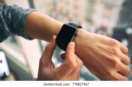 The modern smart watch on the woman's hand