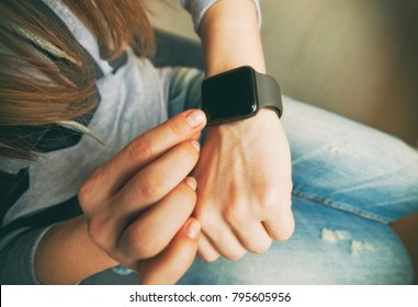The modern smart watches on the woman's hand