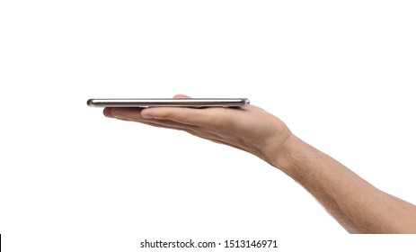 Modern smartphone flat lying on open male palm, side view panorama with copy space