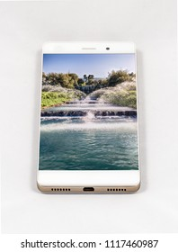 Modern smartphone with full screen picture of waterfall in Rome, Italy. Concept for travel smartphone photography.