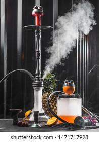 Modern smoky hookah with orange and pineapple.