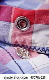 Modern snap fastener button for clothing macro close up