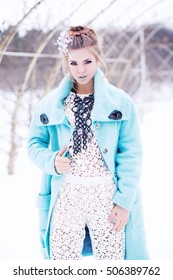 The modern Snow Queen, the beautiful, young, attractive girl in a fantastic image with an unusual make-up