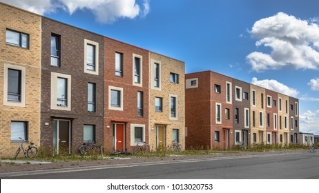 Modern Social housing under blue sky in terra colors containing modest family apartment houses in Ypenburg, The Hague, Netherlands
