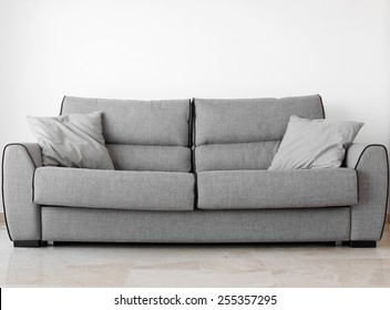 modern sofa in an interior room view