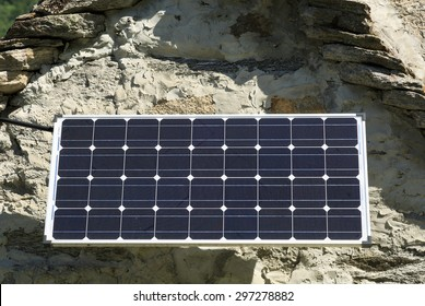 Modern solar panel on an old house in Ticino, Switzerland
