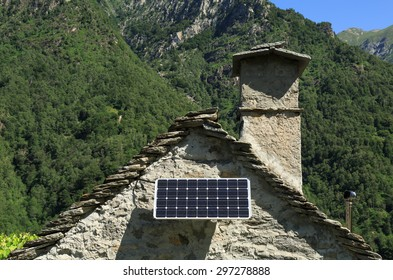 Modern solar panel on an old house in the mountains of Ticino, Switzerland