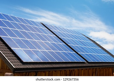 Modern solar panels on house roof in Europe.