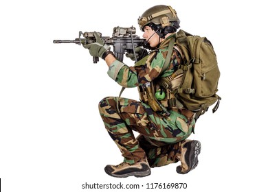 Modern soldier with rifle isolated on a white background. war, army, weapon and people concept.