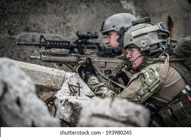 modern soldiers defending their position, in ruins