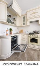 Modern spacioius beige colored luxury kitchen, dishwasher door open