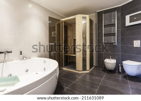 Modern spacious bathroom interior jacuzzi bath stock photo edit