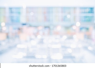 MODERN SPACIOUS OFFICE BACKGROUND, BLURRED LARGE BUSINESS INTERIOR WITH BOKEH LIGHTS