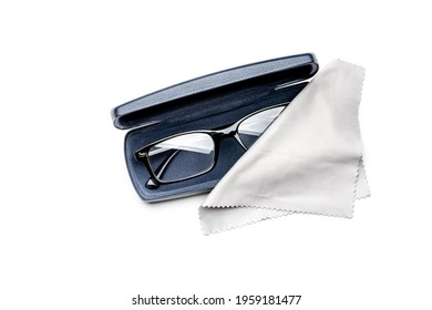 Modern spectacles, or eyeglasses, with a microfiber cloth, in a dark blue leather case, isolated on a white background