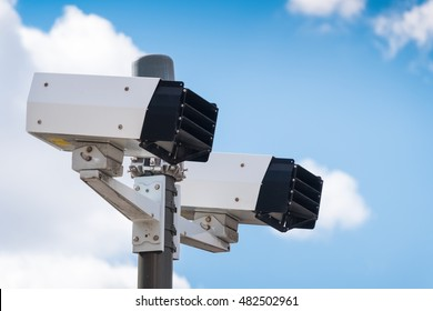 Modern speed camera with sky on the background