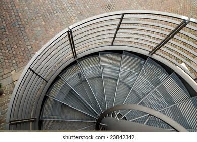 modern spiral steel stairs in urban environment