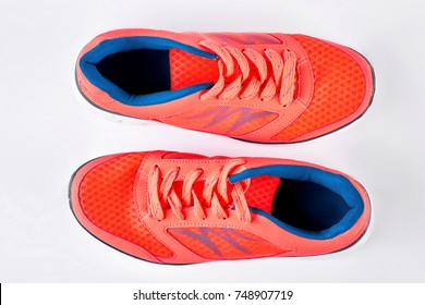 Modern sport trainers, top view. Woman fashion sneakers isolated on white background. Shop trendy sport footwear.