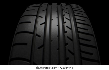 A modern sporty low profile tire on a dark moody studio background - 3D render
