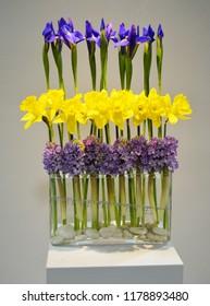 Modern spring floral arrangement in a clear glass vase.