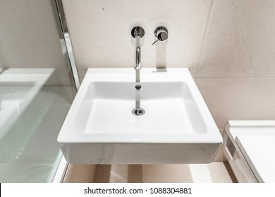 modern, square shape hand wash basin with clean, minimalist fixture