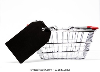 Modern stainless shopping cart with a price tag beside close up.