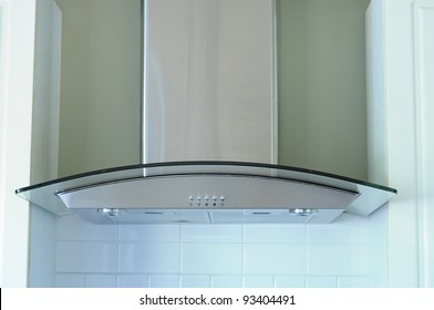 A Modern Stainless Steel And Glass Range Hood Extractor Fan