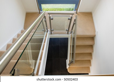 A modern staircase in a newly built property with countryside views