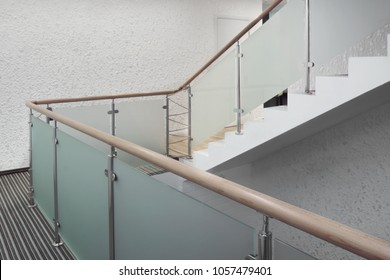 Modern Staircase With Wooden Handrail, Protective Frosted Glass And Stainless Steel Railing System