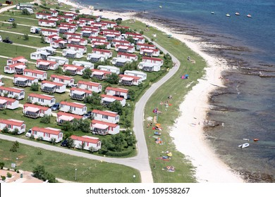 Modern static caravan on campsite during summer near the sea, holiday or vacation scene. Adriatic sea, Croatia - Aerial view