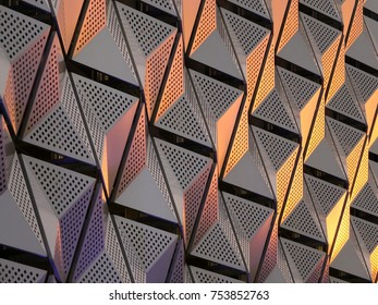 modern steel angular geometric cladding with colour tones and perforated patterned design
