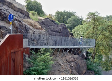 Modern steel construction cycling route to the Ohre River, Kadaň Water Dam in the Czech Republic. The cycle path from the water reservoir runs along the rocky massif.