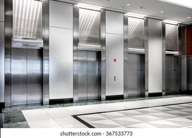 modern steel elevator cabins in a business lobby