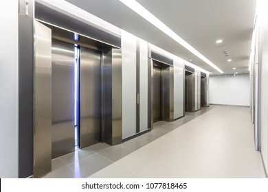 Modern steel elevator door almost open cabins in a business lobby or Hotel, Store, interior, office,perspective wide angle. Four elevators in hotel lobby.
