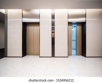 Modern steel elevator door almost open cabins in a business lobby or Hotel, Store, interior, office,perspective wide angle. Three elevators in hotel lobby.