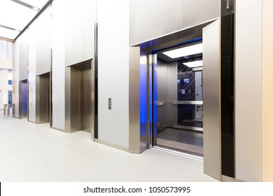 Modern steel elevator opened cabins in a business lobby or Hotel, Store, interior, office,perspective wide angle. Three elevators in hotel lobby.