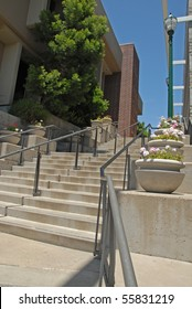 Modern Steps Upward With Flowering Plants and Old Fashion Street Light
