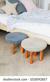 Modern stools with knitted seats and wooden legs in a stylish interior, handmade furniture