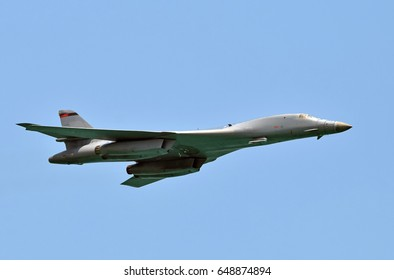 Modern strategic nuclear bomber in flight against blue sky