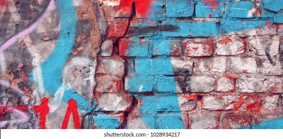 Modern Street Art Background Or Texture. Grunge Brick Wall With Graffiti Art. Urban Surface With Grafiti. Old Building Brickwall With Modern Street Grafitti Art Fragment. Abstract Web Banner