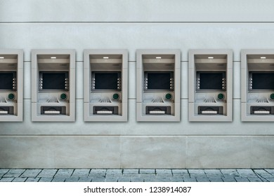 Modern street ATMs for withdrawal of money and other financial transactions.