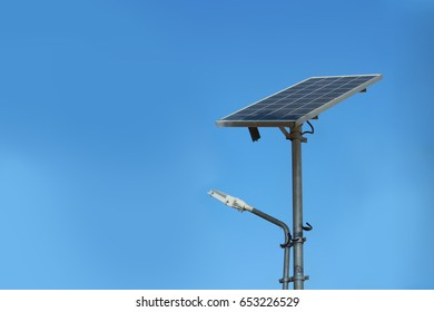 A modern street lamp with a solar battery.
