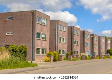 Modern street with large detached family houses in suburb in Groningen Netherlands