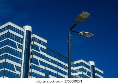 A modern street LED lighting pole. Urban electro-energy technologies. Savings on street urban road lighting. Energy saving. High tech. Eco-friendly smart city system.