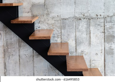 modern structure stair with wooden step and concrete texture background with free copyspace for your text