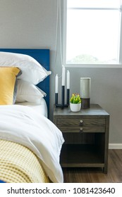 modern style blue and yellow pillow on bed in teenage bedroom