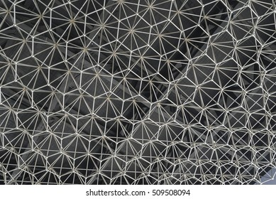 Modern style ceiling decoration with geometric shapes made of chrome metal on a black painted ceiling abstract for background.