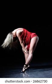 modern style dancer jumping behind studio background