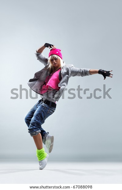 modern style dancer jumping on studio background