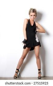 modern style dancer posing behind studio background