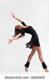 modern style dancer posing on studio background